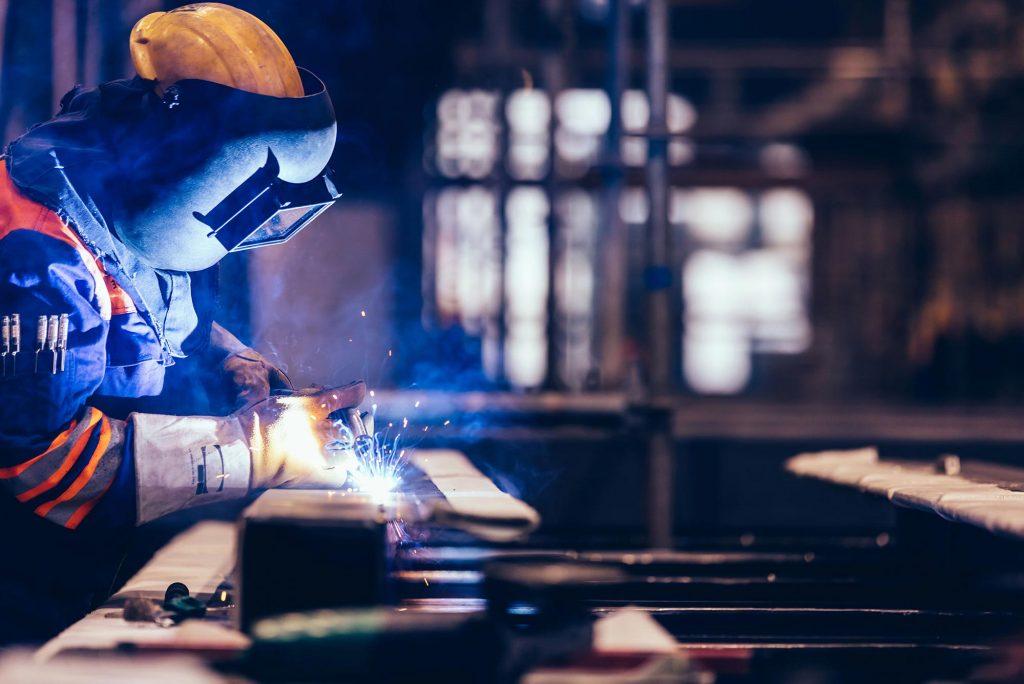 worker-welding-in-a-factory-CAK7CQ8-2.jpg